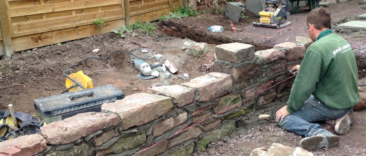 Building a garden wall from stone